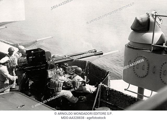 Target practice on an Italian battleship. Practice session on a battleship 'Vittorio Veneto' class, with a coupled weapon system of 37 mm