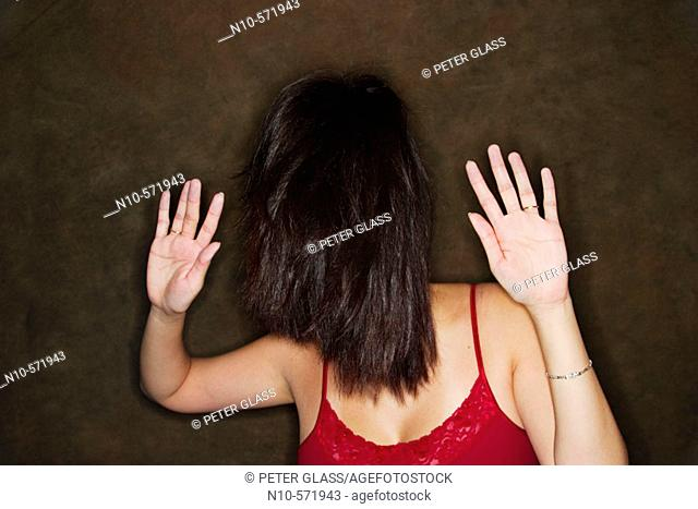 Young Asian woman with her hair covering her face