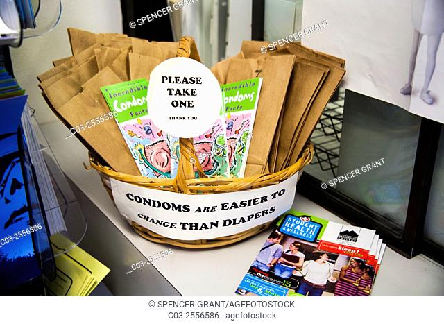 A sign of wise advice decorates a basket of free condoms at a college health clinic in Mission Viejo, CA