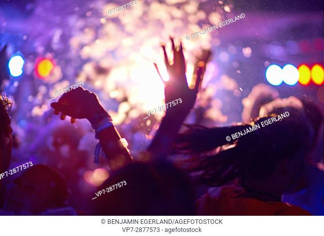 Crowd at music festival in party destination