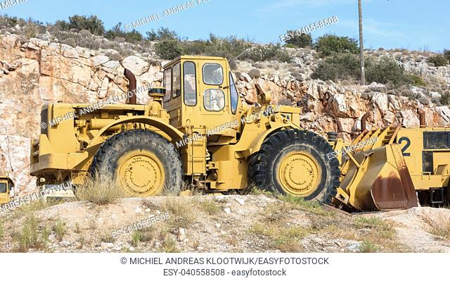 Old industrial bulldozer for stone waiting on a site in Greece