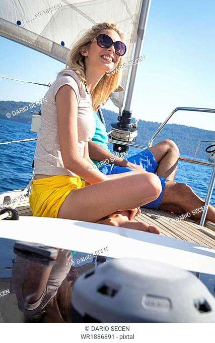 Croatia, Adriatic Sea, Young people on sailboat relaxing
