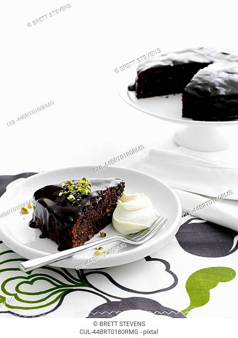 Plate of chocolate cake with cream