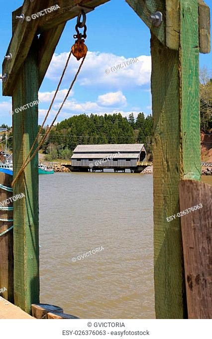covered Bridge in St. Martins, New Brunswick during High Tide on the Bay of Fundy, Canada