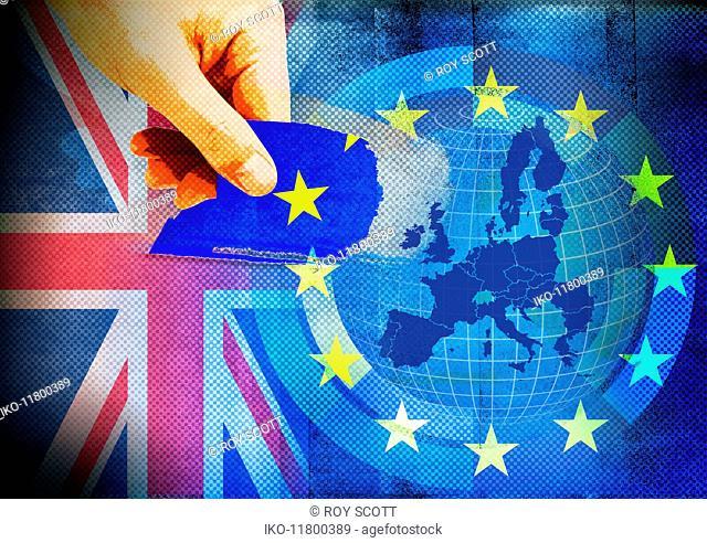 Hand tearing United Kingdom star from European Union flag