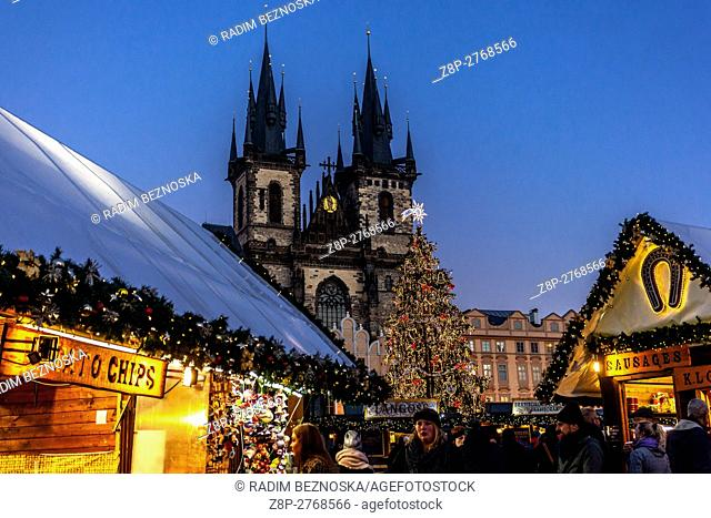 Czech Republic, Prague, Decorated Christmas tree on Old Town Square, shoppers at stalls, Christmas mood