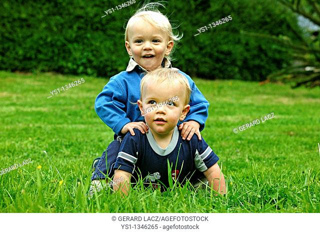 TWIN BROTHERS PLAYING ON GRASS
