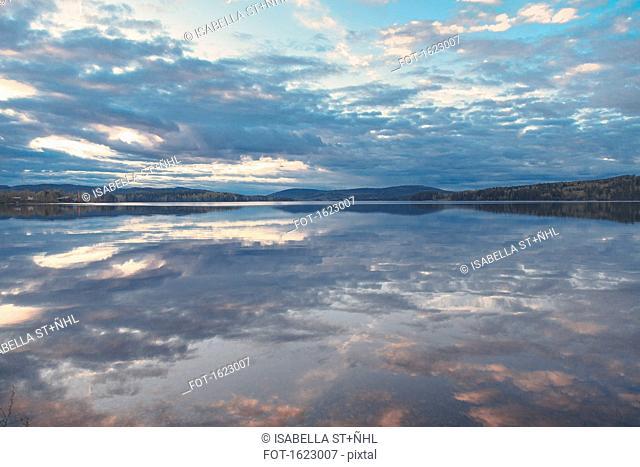 Idyllic view of lake against cloudy sky, J+ñrvs+Â, H+ñlsingland, Sweden