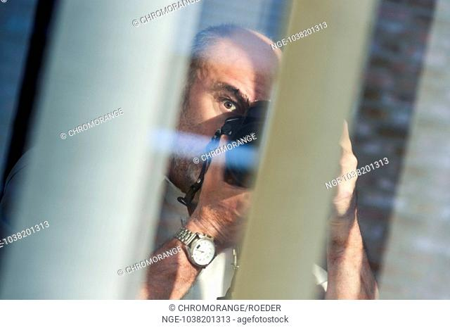 Photographer is hidden behind blinds