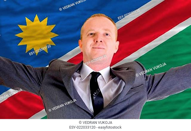 happy businessman because of profitable investment in namibia st