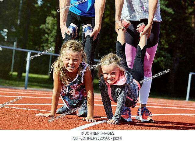 Parents with children on running track