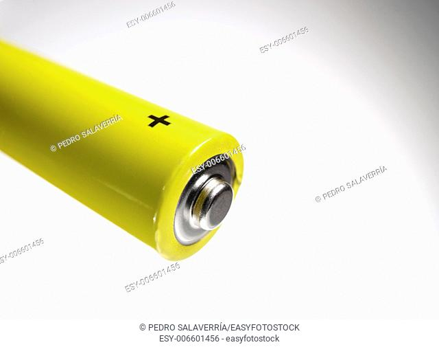 forefront of a AA battery and white background