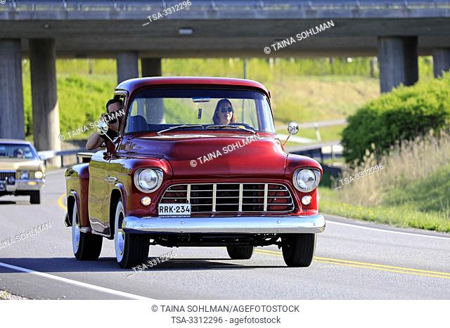 Salo, Finland. May 18, 2019. Woman drives a mid-1950s Chevy pickup, the male passenger is photographing on Salon Maisema Cruising 2019