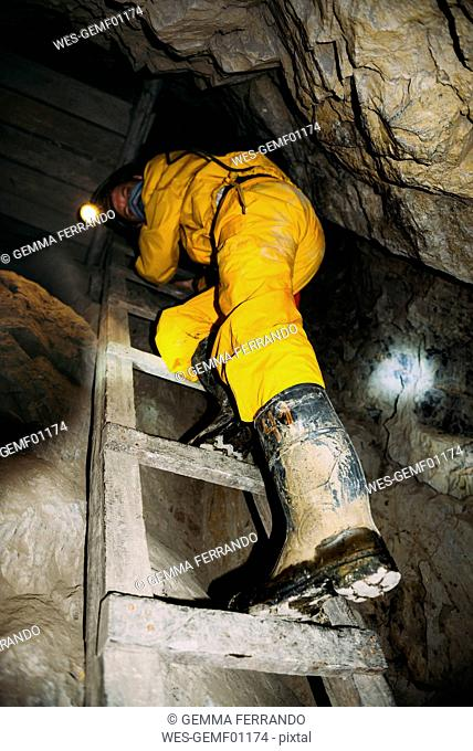 Bolivia, Potosi, tourist wearing protective clothing visiting the Cerro Rico silver mine
