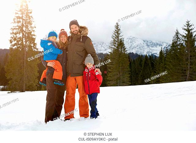 Portrait of parents and sons in snow covered landscape, Elmau, Bavaria, Germany
