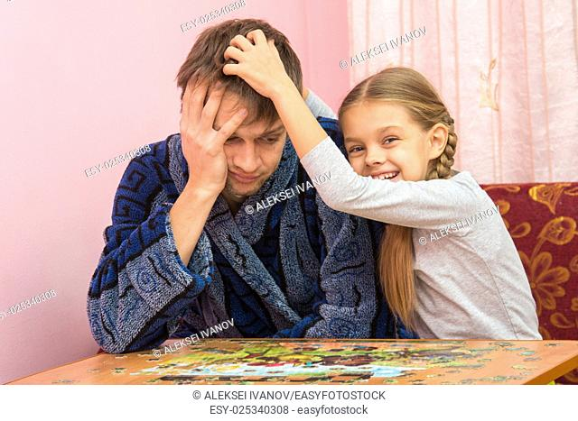 Daughter fun soothes tired dad who collect puzzles