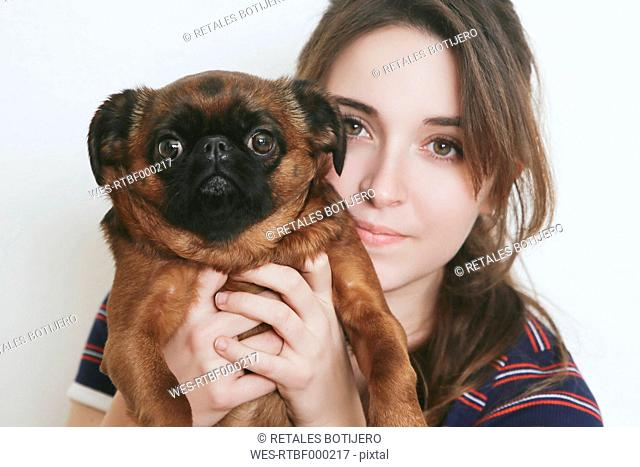 Portrait of young woman and her dog