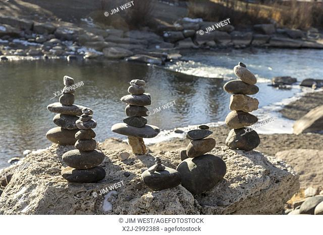Pagosa Springs, Colorado - Stones piled up on the bank of the San Juan River. The town's hot springs and mineral bath resorts attract many tourists