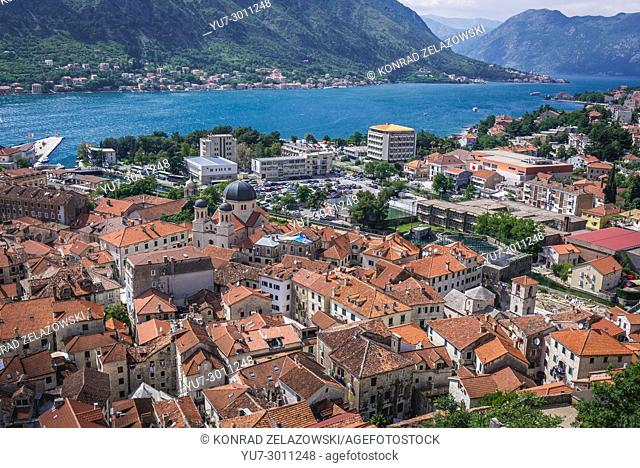 Roofs of Old Town of Kotor coastal city, located in Bay of Kotor of Adriatic Sea, Montenegro. View with Church of Saint Nicholas