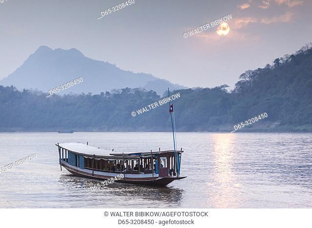 Laos, Luang Prabang, Riverboats on the Mekong River, sunset