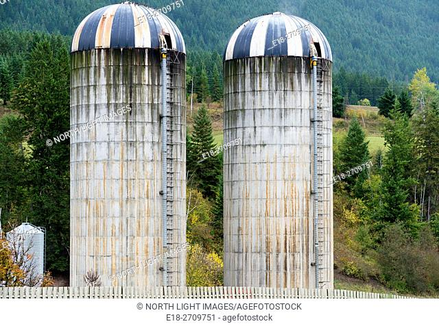 Grain silos on farm beside highway 1, Chase, BC, Canada