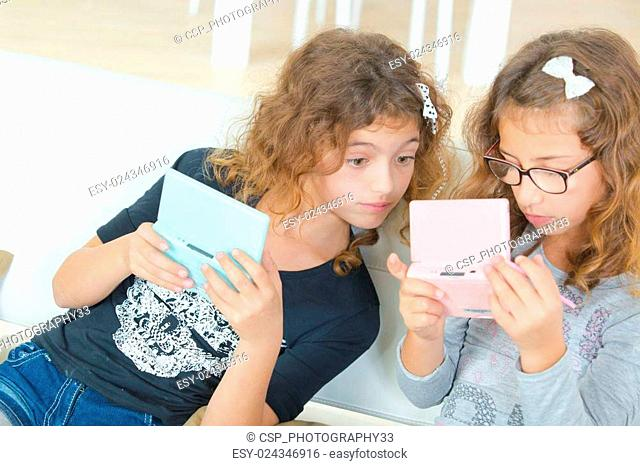Two sisters playing a video game