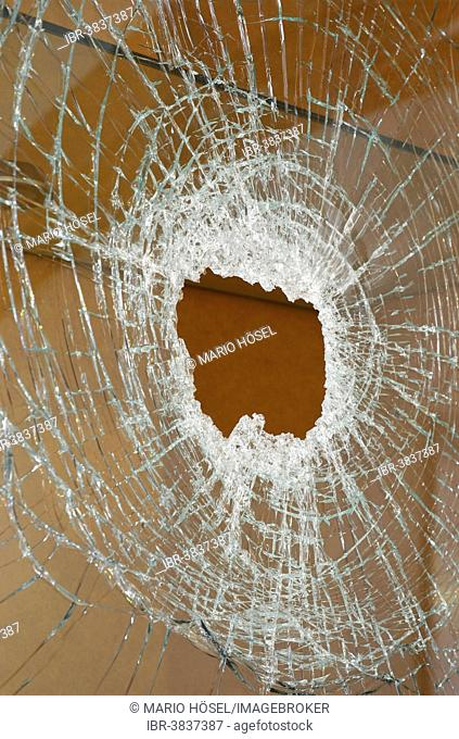 Vandalism, smashed pane of glass of a display cabinet, Germany