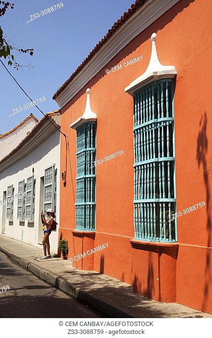 Tourist in front of the colonial buildings at the historic center, Cartagena de Indias, Bolivar, Colombia, South America