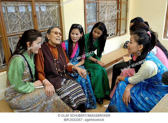 Participants and the later winner of the Miss Tibet in Exile 2011 beauty contest, Tenzin Yangkyi in Dharamsala in conversation with the writer Ade Ama