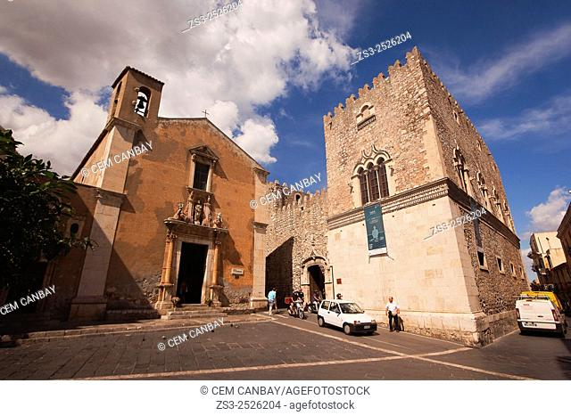 People in front of the Chiesa Santa Catarina church and Palazzo Corvaja, Taormina, Sicily, Italy, Europe