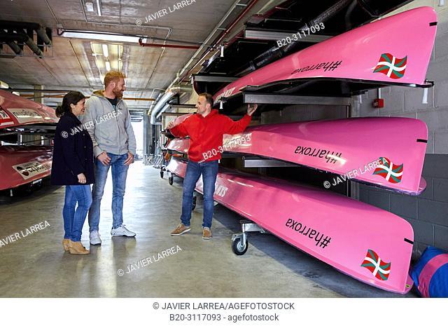 Guide teaching tourists the Traineras in the rowing club, Rowing Company Koxtape, Pasajes de San Juan (Pasaia), Gipuzkoa, Basque Country, Spain, Europe