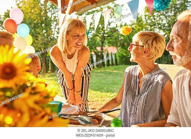 Happy extended family having a garden party