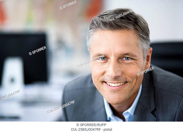 Man in suit smiling to camera