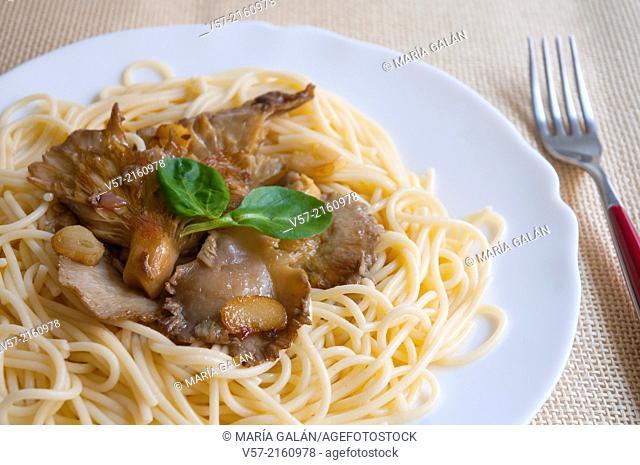 Spaghetti with mushrooms. Close view