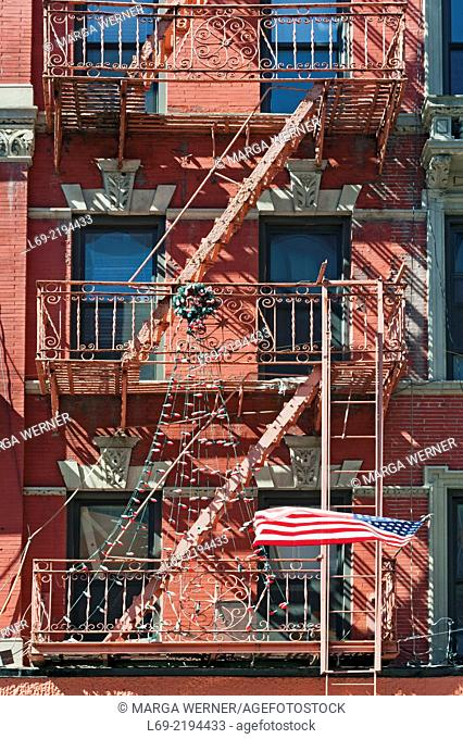 Apartment buildings with outside fire escape ladder, Little Italy, Manhattan, New York