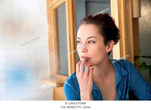 Young woman with thoughtful expression