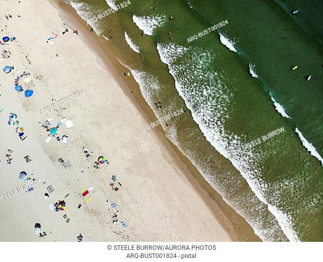 Beachgoers and surfers enjoy the sunshine at Nauset Beach in Cape Cod, Massachusetts over Labor Day Weekend. One of the more popular beaches in the northeastern...