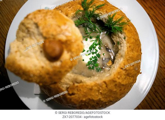 Mushroom soup served inside a bread roll. At mealtime, it is typical to start with a soup, to combat the cold I usually do