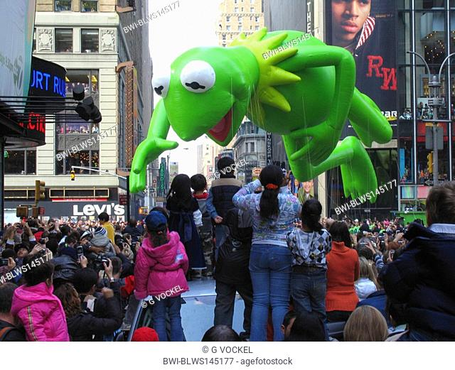 Big balloon is being carried through a crowded street during the Thanksgiving Parade, USA, Manhattan, New York