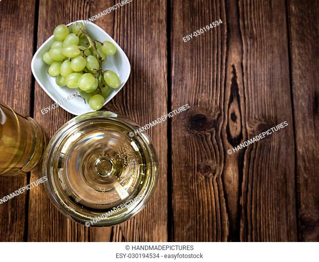 White Wine on an old vintage wooden table