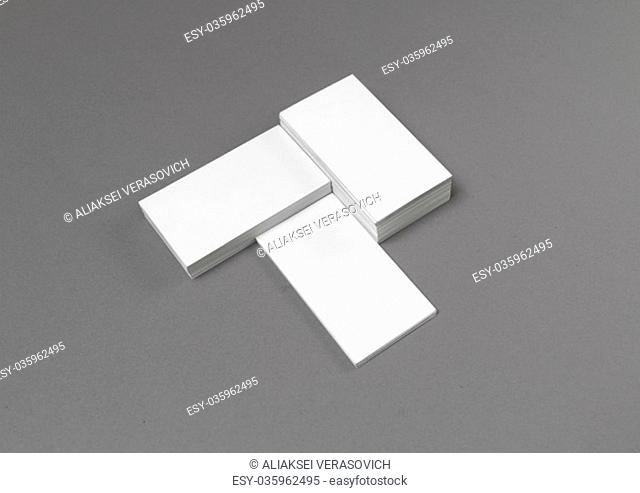 Empty blank business cards on gray paper background