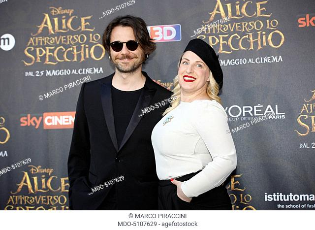 Italian comedians Angelo Pisani and Katia Follesa posing on the red carpet at the national premiere of the film Alice Through the Looking Glass staged at...