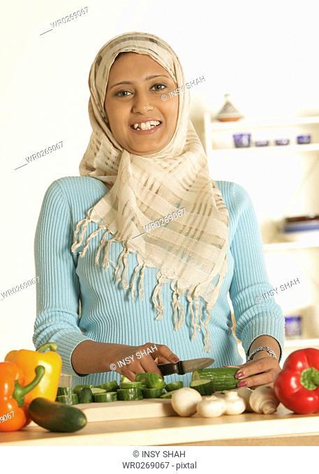 Arab Lady prepares the food