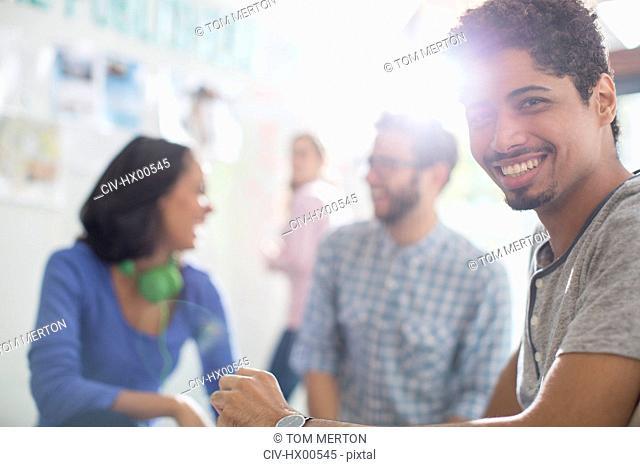 Portrait confident creative businessman in meeting