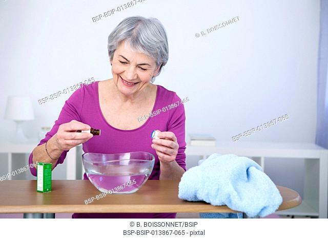Elderly person taking inhalation