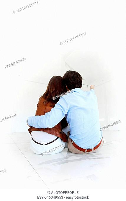 Couple at empty apartment