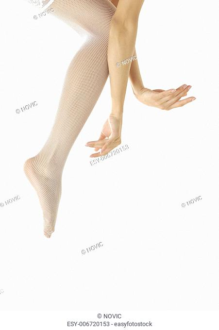 Close-up photo of the woman legs and hands dancing