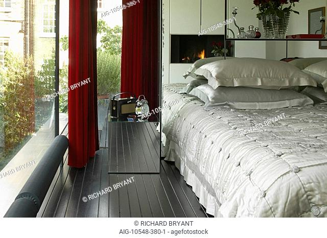Refurbished house in Camden Town. Master bedroom with mirrored headboard. Architect: Munkenbeck and Marshall. Mirror Cube by Rebecca Newnham
