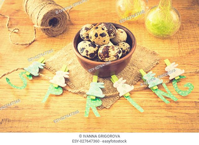 Spring and Easter composition with quail eggs on wooden table