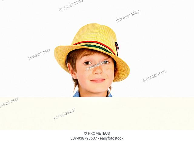 Portrait of a cute 7 year old boy standing with white board. Isolated over white background. Copy space